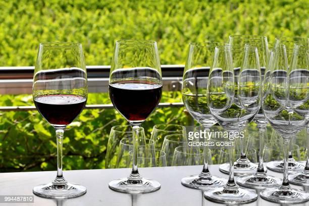 A picture taken on July 5 2018 in Saint Emilion near Bordeaux shows glasses of wine at the Chateau La Grace Dieu des Prieurs estate owned by Russian...