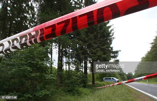 Picture taken on July 6 2016 shows a police cordon at a forest near Rodacherbrunn eastern Germany where remains of alleged murder victim Peggy...