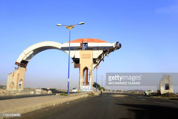 A picture taken on July 6 2019 shows a gate damaged during past Saudiled coalition air strikes in the province of Amran some 50 kilometres north of...