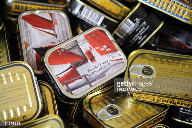 A picture taken on July 8 2013 shows cans of sardines in olive oil at the Gonidec canning fish factory in Concarneau western of France Gonidec...