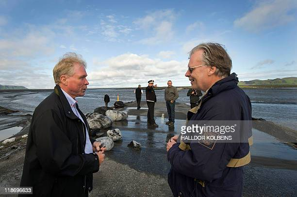 A picture taken on July 9 2011 shows Icelandic Minister of Interior Gmundur Jonasson talking with Icelandic Road Administration director Hreinn...
