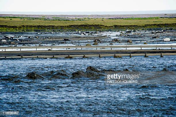 A picture taken on July 9 2011 shows partially flooded road number 1 near Vik after a massive flood of meltwater poured out of Iceland's...