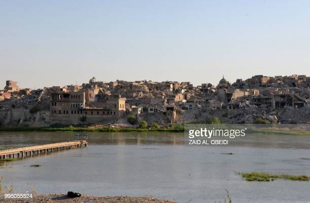 A picture taken on July 9 2018 shows a view of destruction in the old city of Mosul as seen from the opposite side along the Tigris river a year...