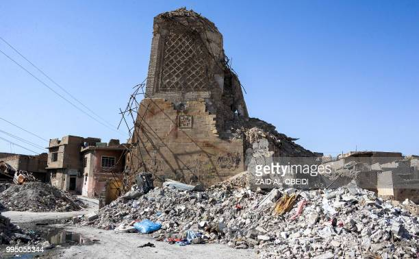 A picture taken on July 9 2018 shows a view of the base of the destroyed AlHadba leaning minaret in the Old City of Mosul a year after the city was...
