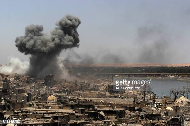 A picture taken on July 9 shows smoke billowing following an airstrike by USled international coalition forces targeting Islamic State group in Mosul...
