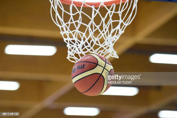 A picture taken on June 1 2017 shows a basket and a ball before a friendly basketball match between France and Canada on June 1 in Villenaved'Ornon...