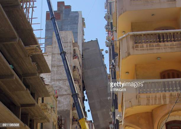 A picture taken on June 1 2017 shows a general scene of a highrise residential building toppling over as it leans on another tall building in a...