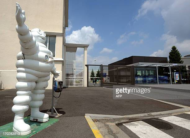 A picture taken on June 10 2013 shows a Michelin Bibendum at the gate of the truck tyre factory in Joue Les Tours after the French tyre manufacturer...
