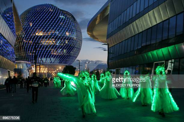 A picture taken on June 10 2017 shows dancers as they perform at the EXPO2017 International exhibition in Astana / AFP PHOTO / Aleksey FILIPPOV