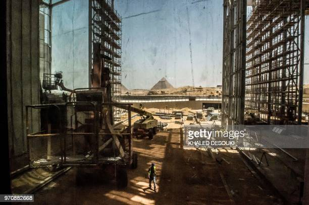 TOPSHOT A picture taken on June 10 2018 shows a view of construction work undergoing at the site of the Grand Egyptian Museum in Giza on the...