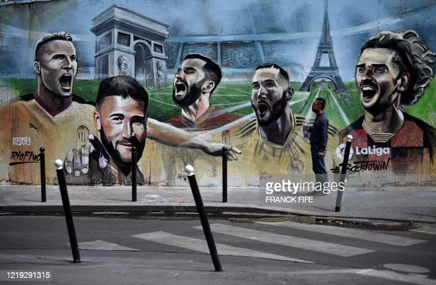 Picture taken on June 10 shows a mural signed Ernesto Novo in a street in Paris depicting French football players playing in Spain's La Liga Valencia...