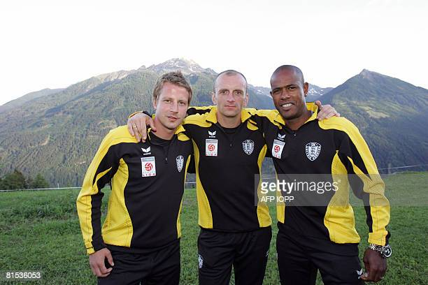 A picture taken on June 13 2007 shows players from the SK Austria Kaernten football club Thomas Riedl Adam Ledwon and Cuinquinho da Silva posing at a...