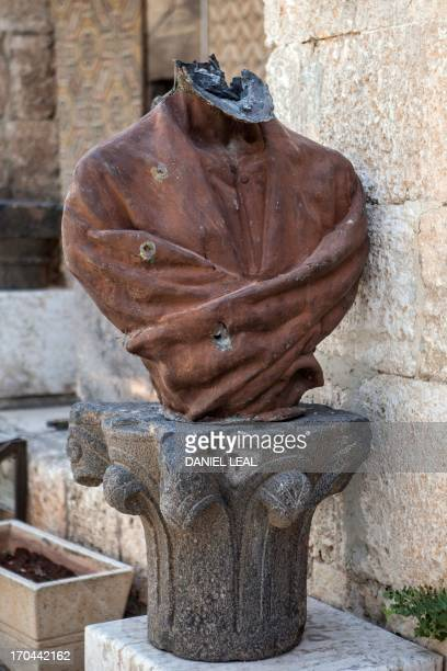 A picture taken on June 13 2013 shows a beheaded statue of Abu alAlaa alMaari a famous blind Arab philisopher and poet displayed at the alMaraa...