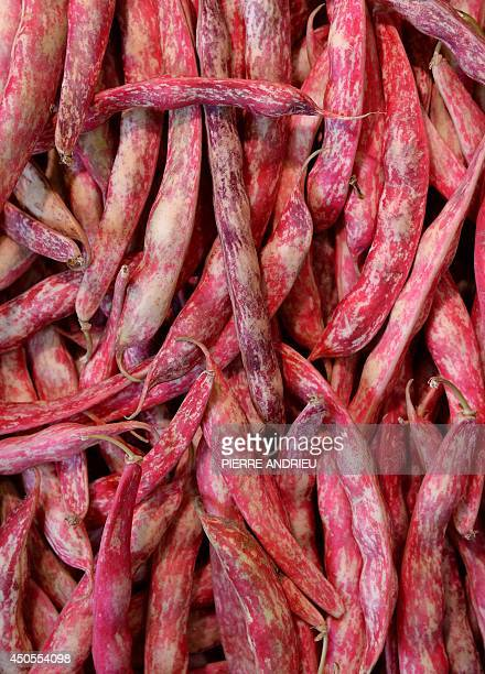 A picture taken on June 13 2014 shows red coco beans in a local business in Paris AFP PHOTO / PIERRE ANDRIEU