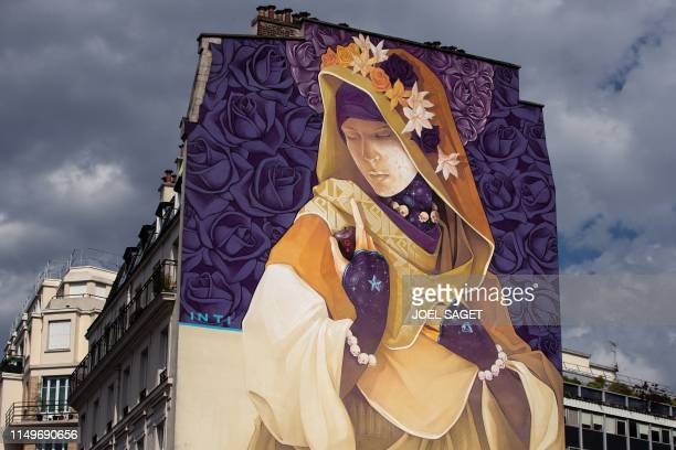 A picture taken on June 13 2019 shows a mural titled La Madre Secular 2 by streetartist INTI as part of the open air streetart display Boulevard...