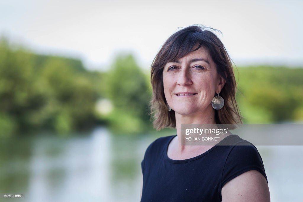 A picture taken on June 13, 2017, shows Sandra Marsaud, urbanist, municipal councilor of Saint-Meme-les-Carrieres and French La Republique En Marche (LREM) party candidate in the 2nd constituency of Charente posing in Jarnac, central France, ahead of the second round of France's legislative elections. France heads to the polls on June 18, 2017, for the second round of legislative elections, with Macron's year-old La Republique En Marche party and its allies tipped to clean up for the 577-member lower house of parliament, winning up to 445 seats. / AFP PHOTO / Yohan BONNET