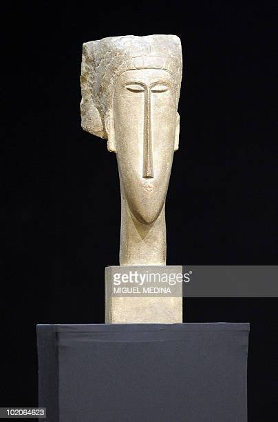 Picture taken on June 14 2010 at Christie's France auction house in Paris of a limestone Women 'Head' carved by Italian sculptor and painter Amadeo...