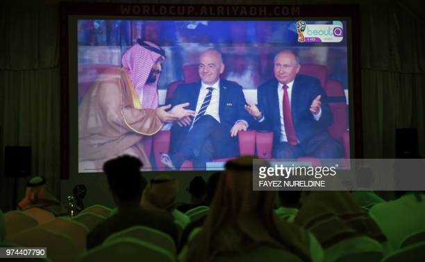 A picture taken on June 14 2018 in a Saudi football fan tent in the capital Riyadh shows a projector showing the Russia 2018 World Cup Group A...