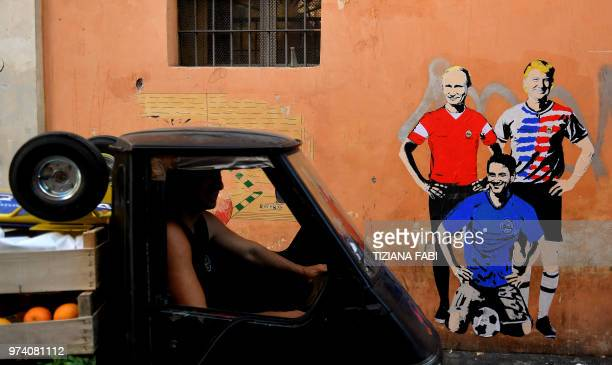 TOPSHOT A picture taken on June 14 2018 in central Rome shows a mural by the street artist known as 'TV Boy' depicting US President Donald Trump...