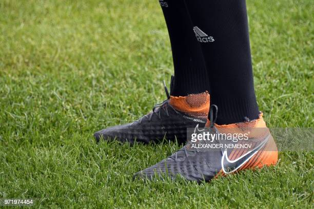 A picture taken on June 140 2018 shows the football shoes of Iran's midfielder Saeid Ezatolahi upon his arrival to take part in a training session in...