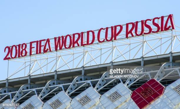A picture taken on June 15 2018 shows the 2018 FIFA World Cup sign on top of the Spartak football stadium in Moscow on the eve of the match between...