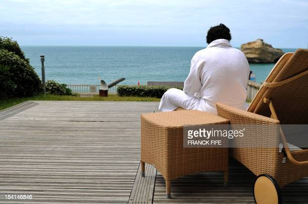 A picture taken on June 15 shows a client resting in front of the sea in the luxury hotel 'Hotel du Palais' in Biarritz Southwestern France This...