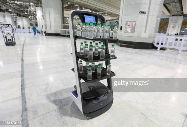Picture taken on June 15 shows a smart robot used for the first time at the Grand Mosque in Saudi Arabia's holy city of Mecca, supplying worshippers...