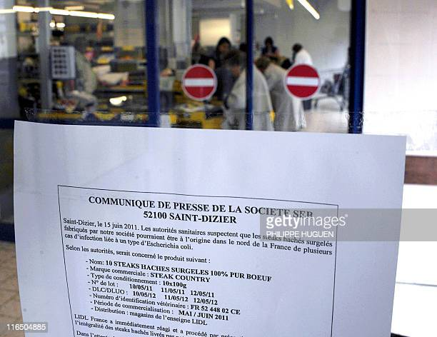 A picture taken on June 16 2011 in the northern French town of Lille shows a note from French company SEB at the entrance of a discount supermarket...