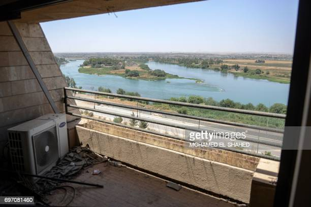 A picture taken on June 16 2017 shows a view of the Tigris river outside from a balcony of the Nineveh International Hotel compound in Iraq's...