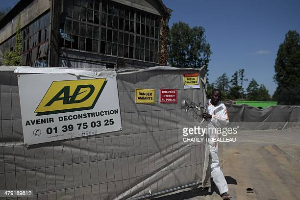 COUPEAU A picture taken on June 17 2015 in Caligny northwestern France shows a worker closing the access to an asbestos removal site AFP PHOTO/CHARLY...