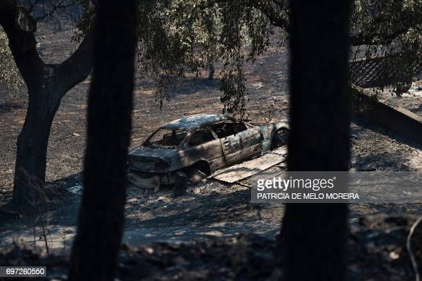 A picture taken on June 18 2017 shows a car burnt after a wildfire in Figueiro dos Vinhos A wildfire in central Portugal killed at least 57 people...