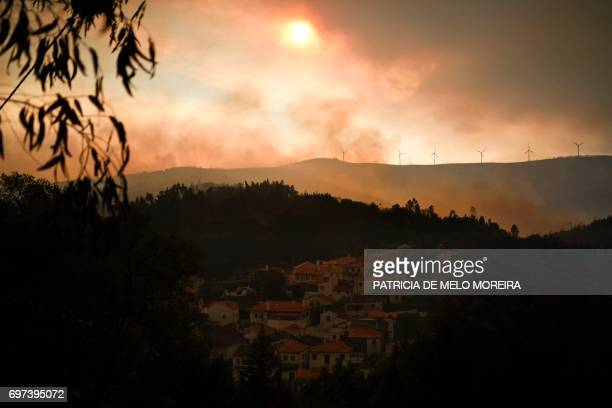 Picture taken on June 18, 2017 shows the village of Campelo after a wildfire, from Figueiro dos Vinhos. Portugal declared three days of national...