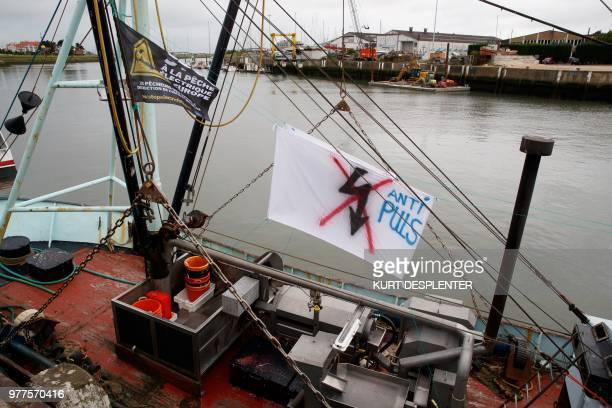 Picture taken on June 18, 2018 at the Nieuwpoort harbour shows a sign on a boat during a protest of French fishermen against the use of electricity...