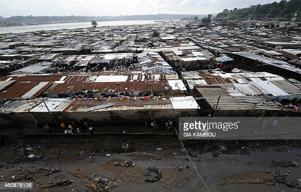 A picture taken on June 19 2014 shows a general view of a poor neighborhood in the Attecoube commune central part of Abidjan Twelve people were...