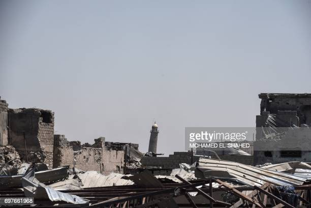 A picture taken on June 19 2017 shows the leaning AlHadba minaret towering over the skyline in Mosul as the Iraqi forces advance towards the Old City...