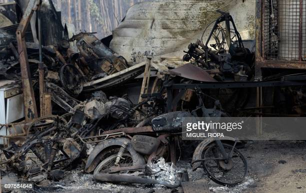 A picture taken on June 19 2017 shows wreckage of a garage in an area devastated by a wildfire close to the village of Figueiro dos Vinhos More than...