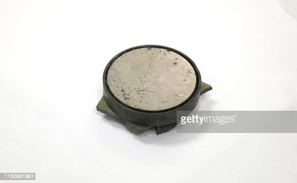 A picture taken on June 19 2019 during a guided tour by the US Navy shows what was presented as a magnet from a mine reportedly found on the...