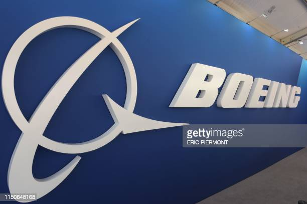 Picture taken on June 19, 2019 shows a Boeing Logo in one of the Boeing's stands at the International Paris Air Show at Le Bourget Airport, near...