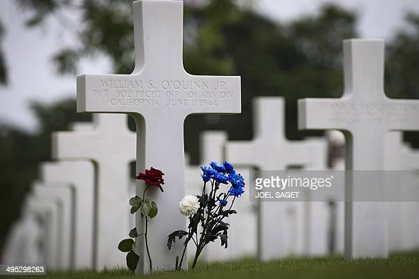 A picture taken on June 2 2014 shows flowers on a grave at the US cemetery in CollevillesurMer ahead of the 70th anniversary of the DDay landings in...