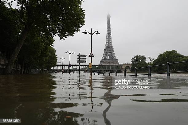 A picture taken on June 2 2016 shows the river Seine bursting its banks next to the Eiffel Tower in Paris Officials were putting up emergency flood...