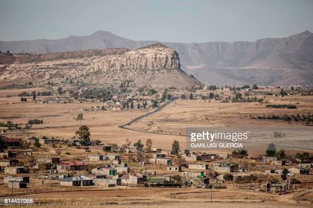 Picture taken on June 2, 2017 shows a general view of a Lesotho village on the outskirts of Maseru, Lesotho. - The red tape of South Africa's...