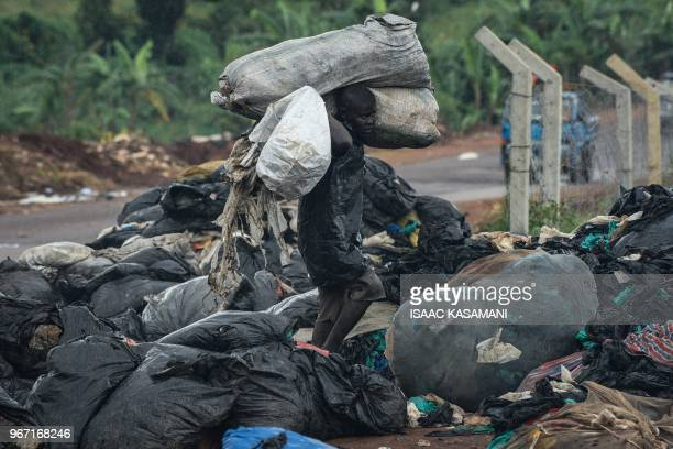 A picture taken on June 2 2018 in Kampala Uganda shows a man bringing plastic bags to be sold off to a factory that recycles them into home plastic...