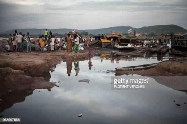 A picture taken on June 2 2018 shows the port of Sao welcoming several hundred travellers a day crossing the river Oubangui to connect the Democratic...