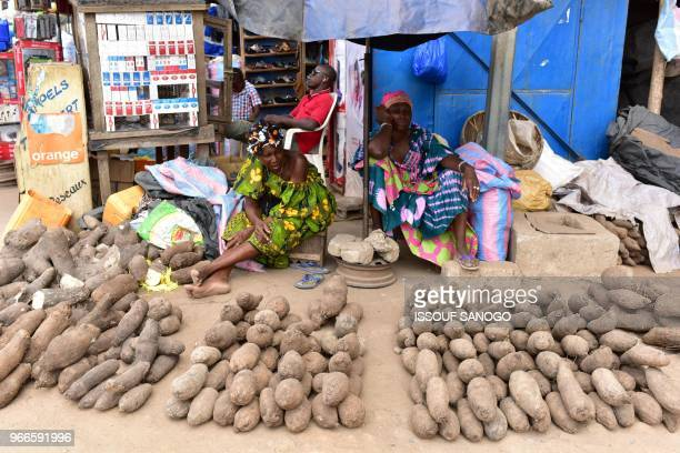 A picture taken on June 2 2018 shows yam seller in the market in Bouake central city of Ivory Coast