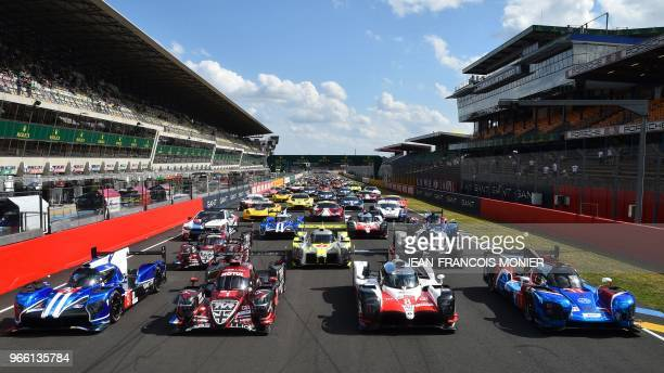 A picture taken on June 2 at the Le Mans circuit northwestern France shows the 60 cars that will compete at the test day of the 86th 24hours...
