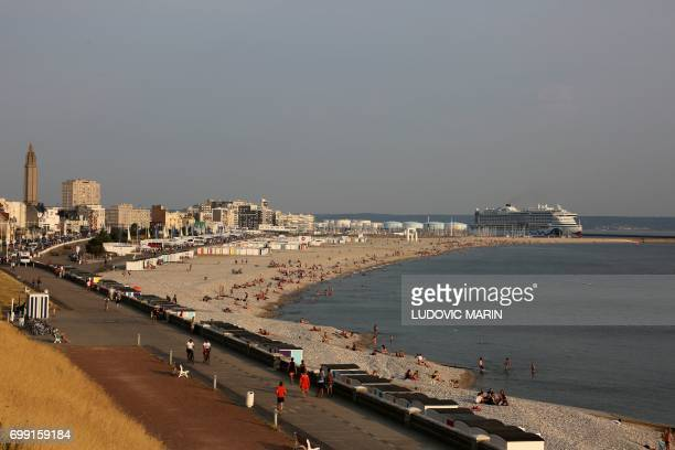 A picture taken on June 20 2017 in Le Havre shows a view of the beach with the Aida Prima cruise vessel operated by the German cruise line AIDA...