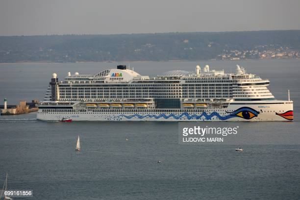 A picture taken on June 20 2017 in Le Havre shows the Aida Prima cruise vessel operated by the German cruise line AIDA Cruises leaving the port / AFP...