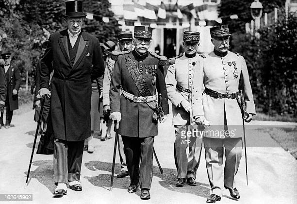 A picture taken on June 21 1930 shows French War Minister Andre Maginot Marshal Joseph Joffre and Marshal Philippe Petain at the inauguration of...