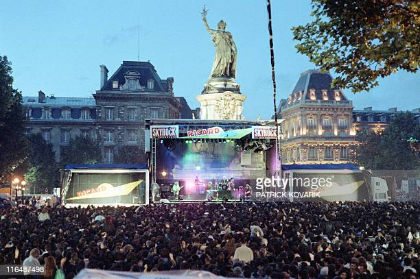 A picture taken on June 21 1990 shows Parisian and tourists gathering at the place de la Republique in Paris to attend an open air concert of the...