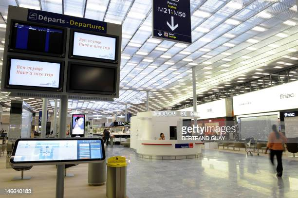 A picture taken on June 21 2012 at RoissyCharlesdeGaulle airport in RoissyenFrance northern Paris shows the new boarding hall of Terminal 2E S4 on...